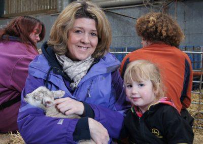 Holding new born lambs